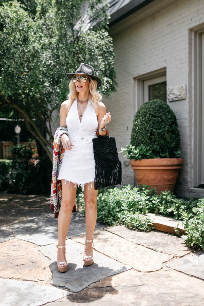 Dallas blogger wearing a white denim skirt and gold wedges