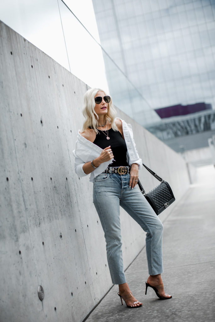 Dallas blogger wearing Gucci belt, white jean jacket, and gold coin necklace