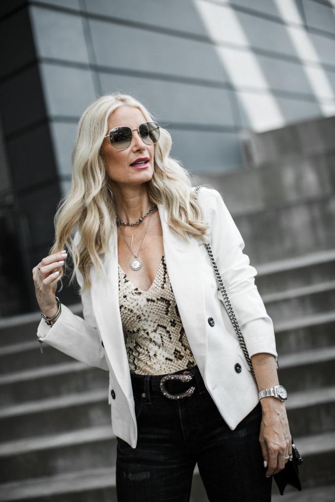 Dallas blogger wearing a white blazer and a snake print bodysuit