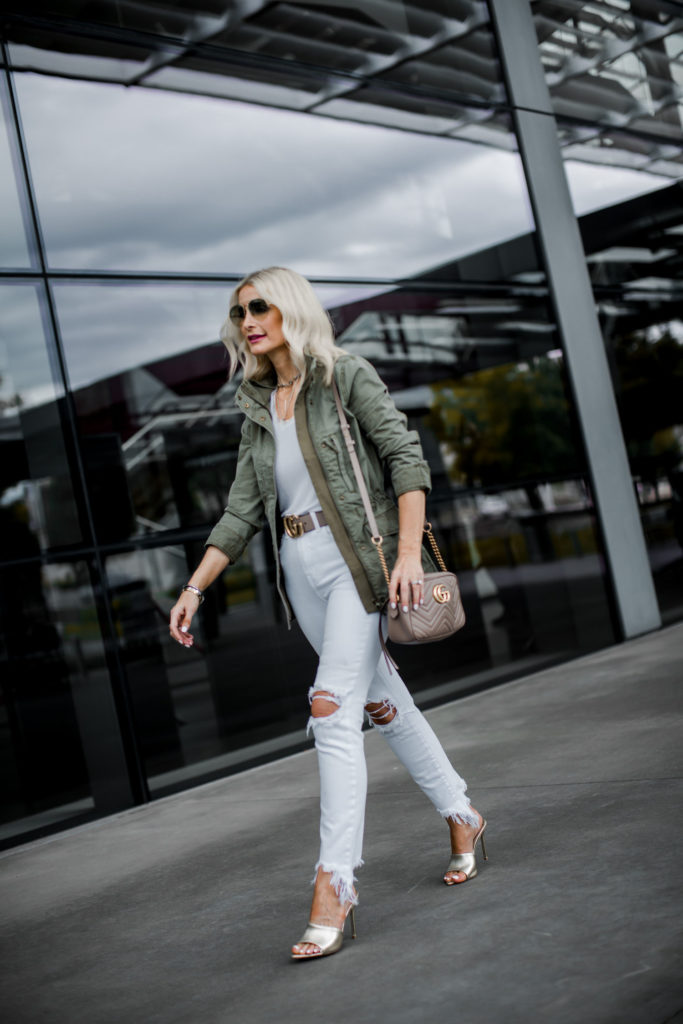Dallas fashion blogger wearing white jeans and a Madewell army jacket