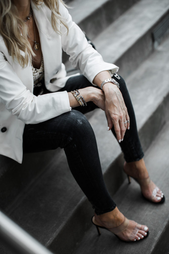 Dallas blogger wearing Moussy jeans and a white blazer