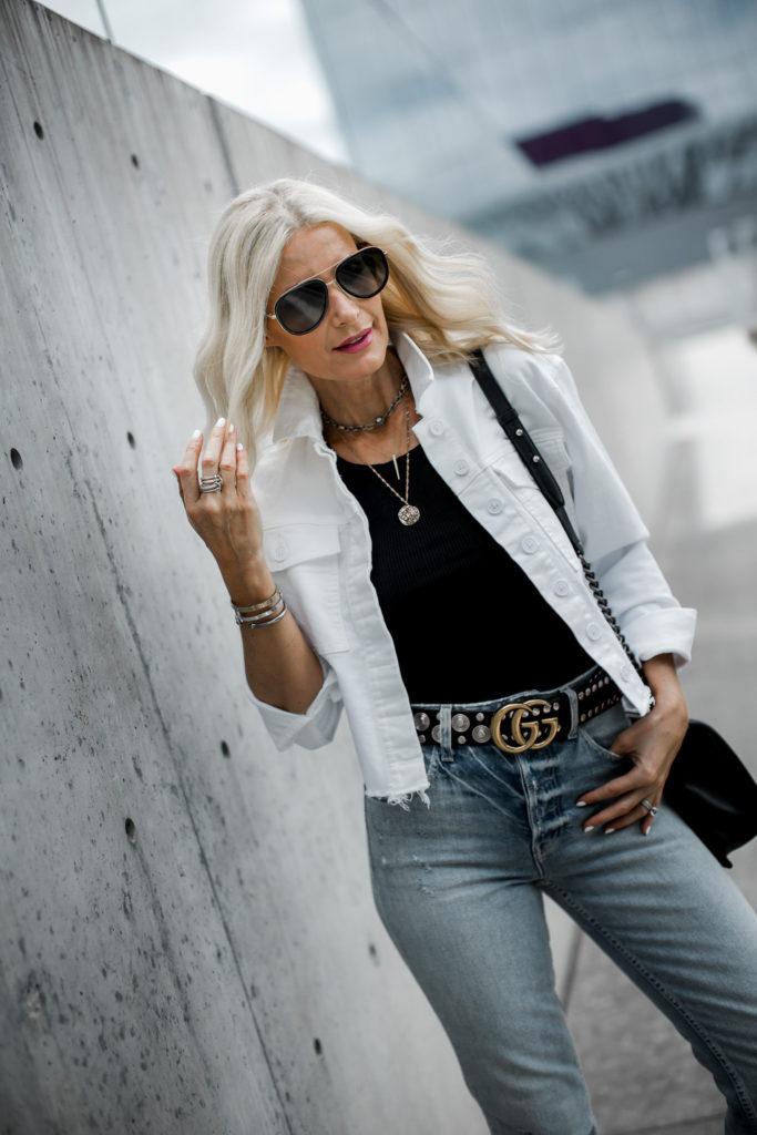 White denim jacket and Gucci belt on Dallas fashion blogger