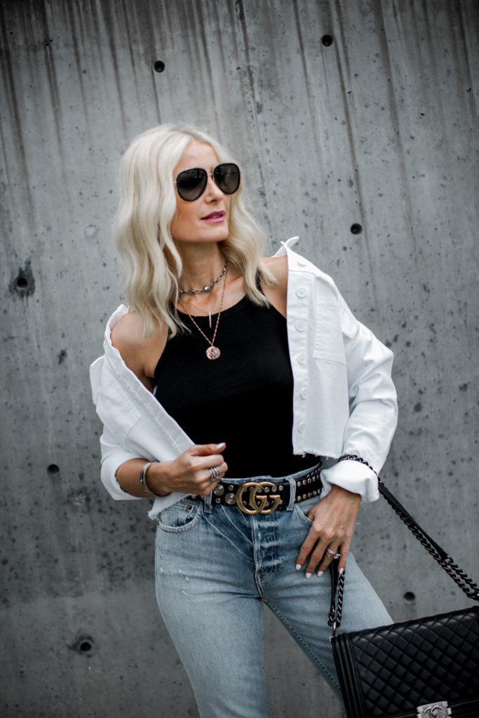 Dallas blogger wearing a white denim jacket and Gucci Belt