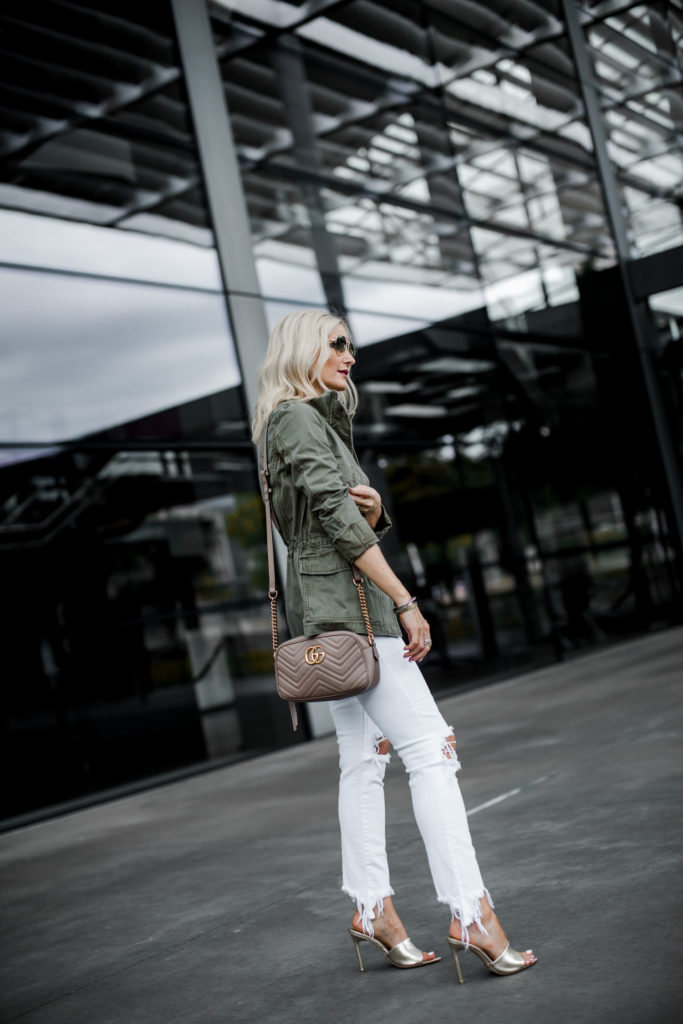 Dallas fashion blogger wearing an army jacket and white L'agence jeans