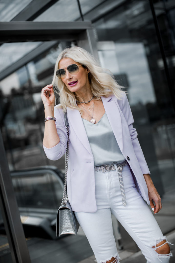 Dallas blogger wearing a blazer and white L'agence jeans