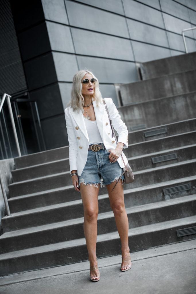 Dallas blogger wearing Balmain blazer and Agolde denim cut-offs