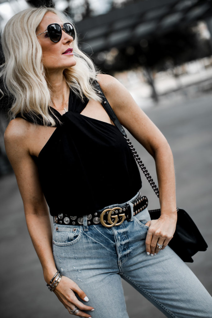 Dallas fashion blogger wearing a Gucci belt, black date night top and Mom jeans