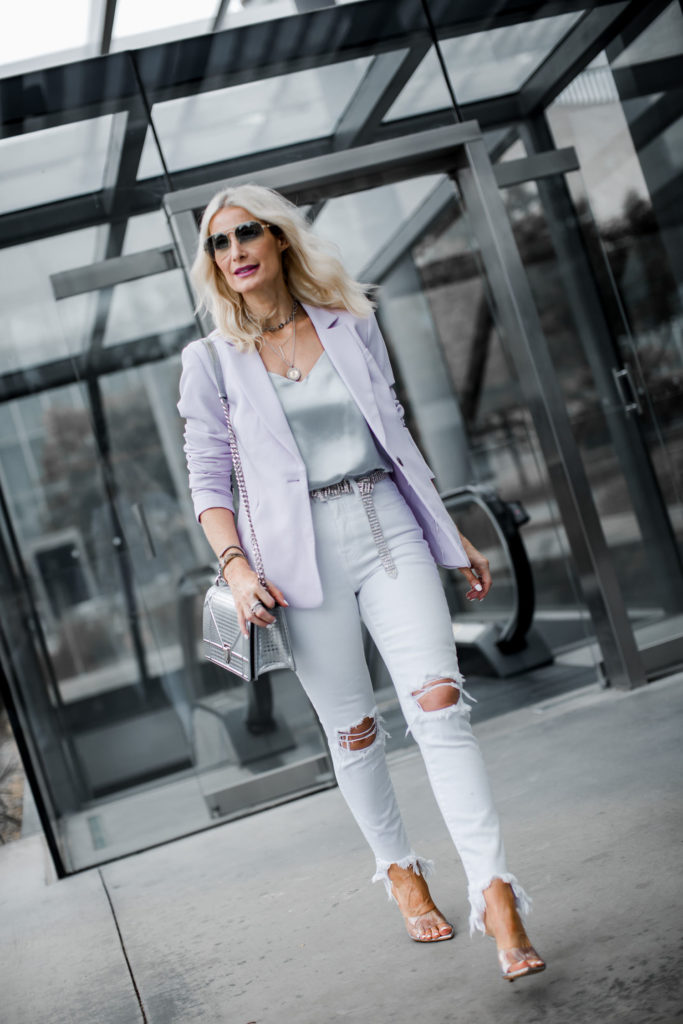 Dallas style blogger wearing blazer and white jeans
