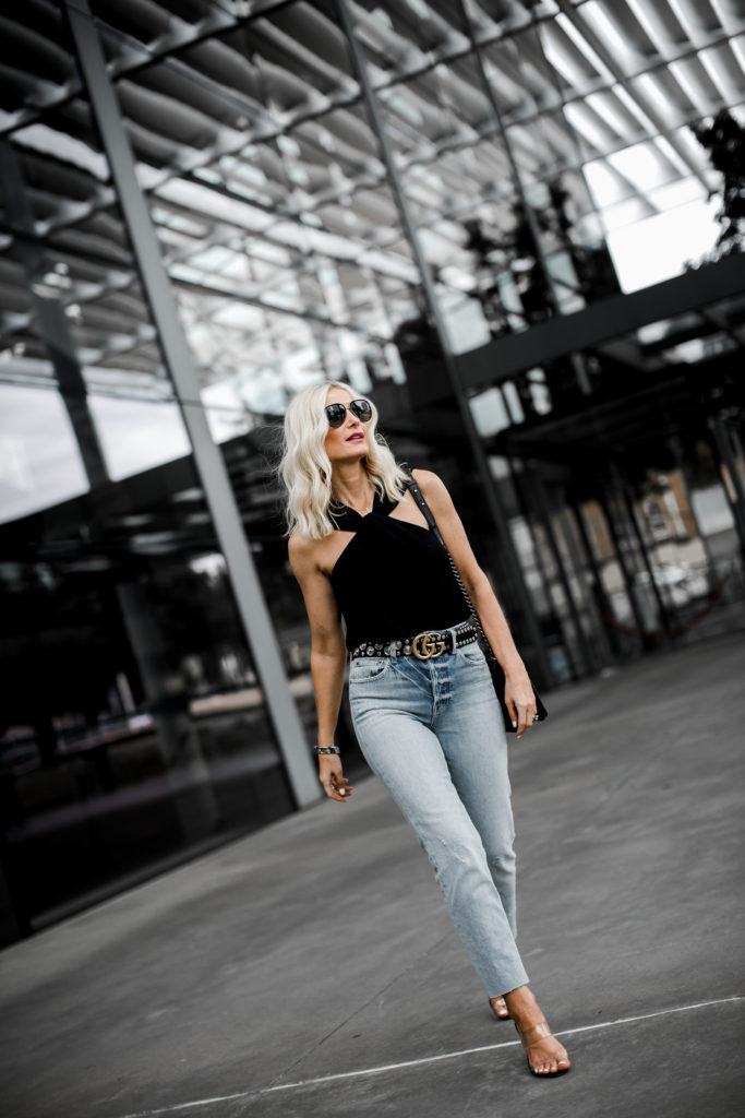 Dallas style blogger wearing a black top and Trave denim
