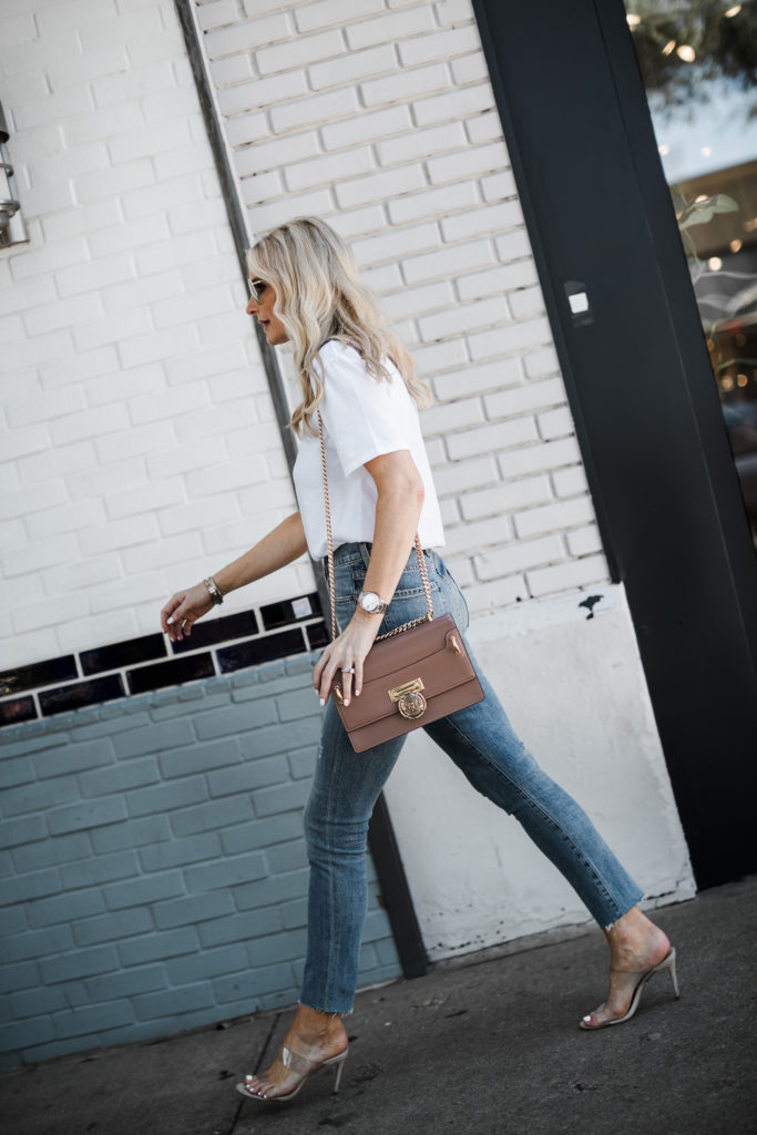 Dallas blogger wearing a white t-shirt and jeans