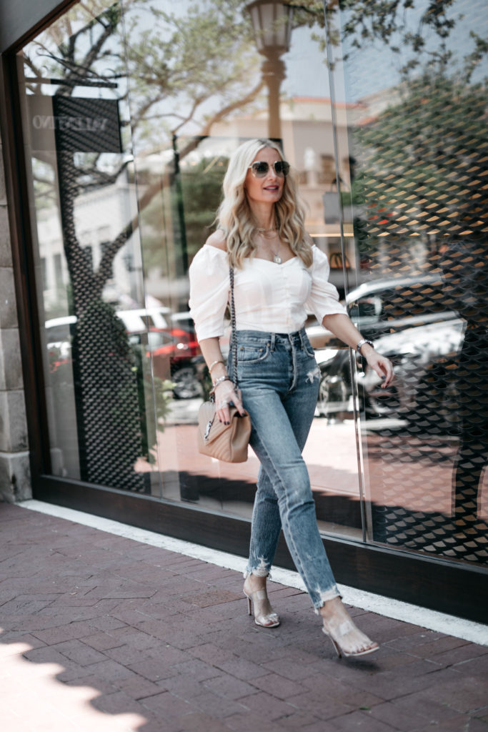 Dallas fashion blogger wearing an off the shoulder top and Agolde denim