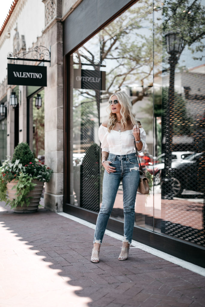 Dallas blogger wearing Agolde jeans and an off the shoulder top by Something Navy