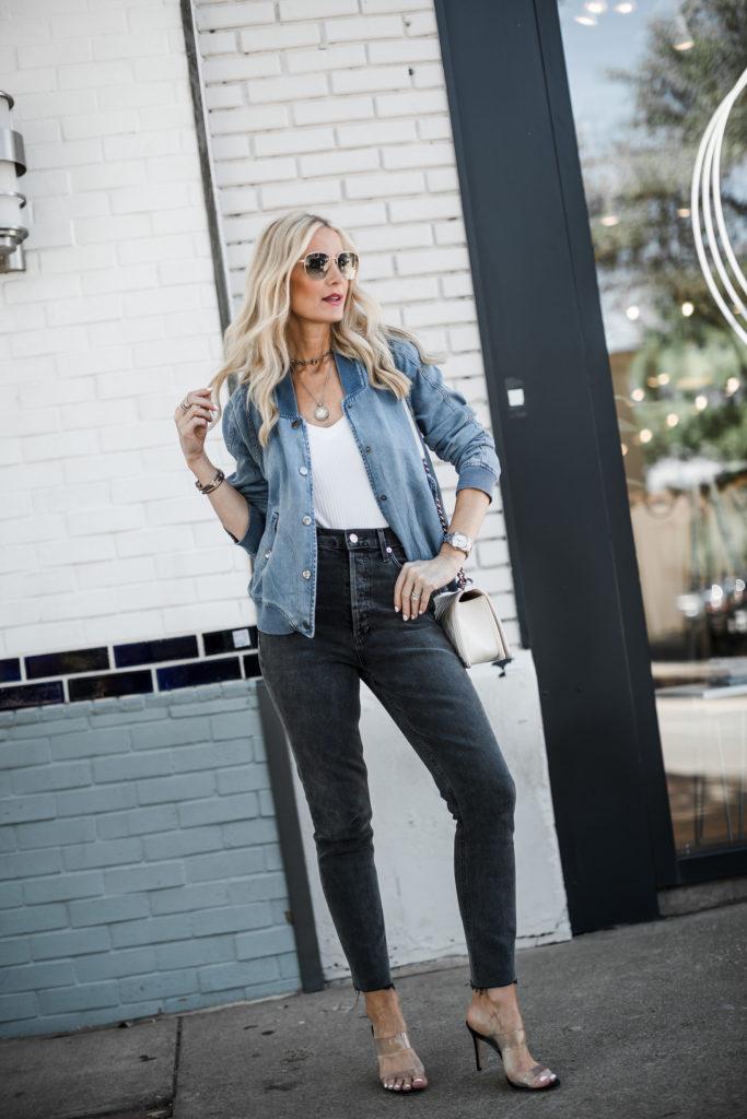 Dallas style blogger wearing Agolde jeans and denim bomber jacket