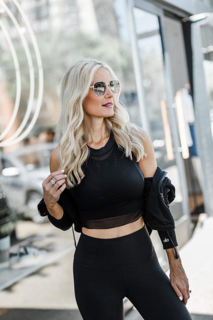Dallas blogger wearing Alo yogo top and leggings