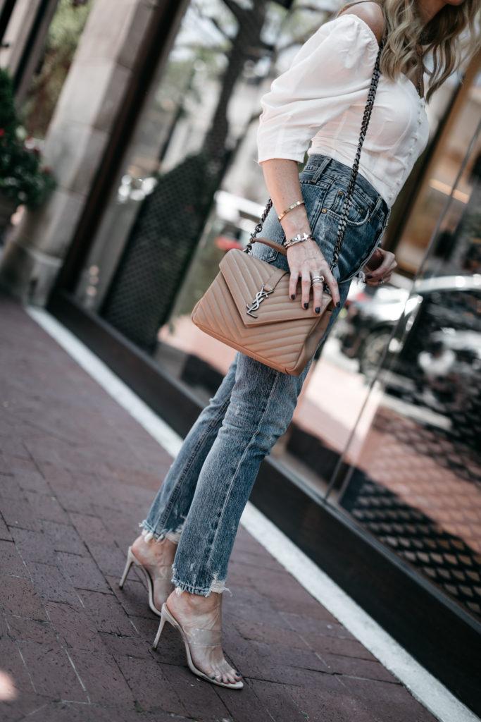 Saint Laurent handbag, Schutz heels, and Agolde jeans