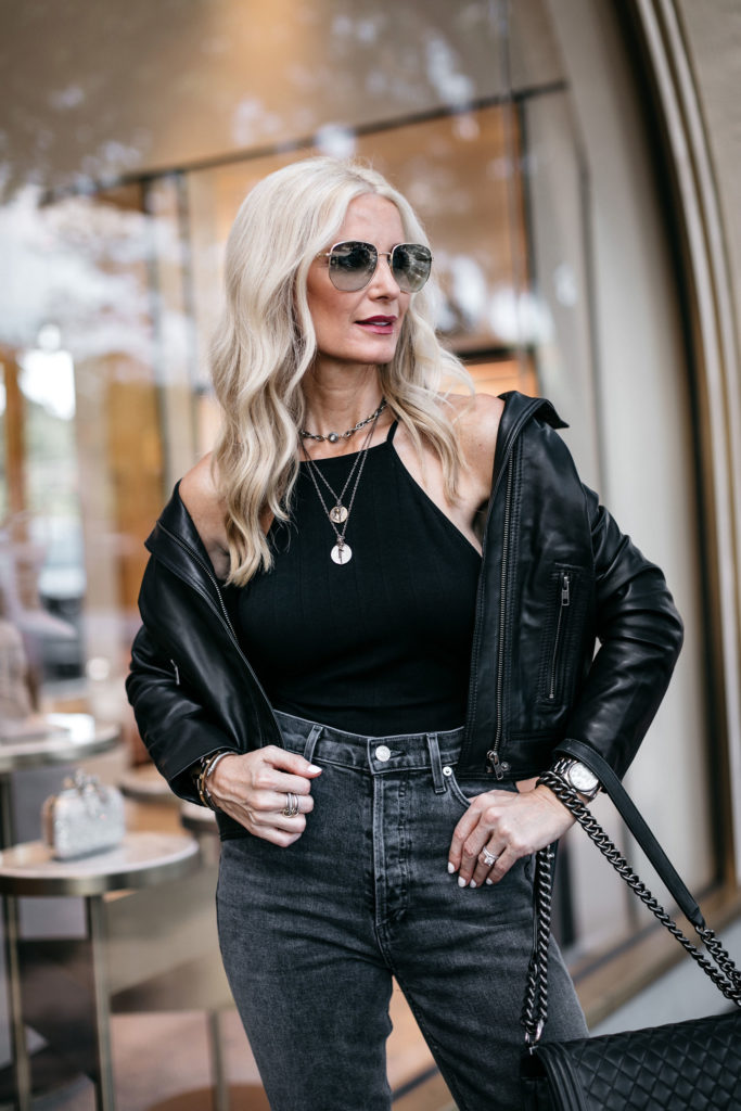 Dallas fashion blogger wearing a black leather jacket and Agolde jeans