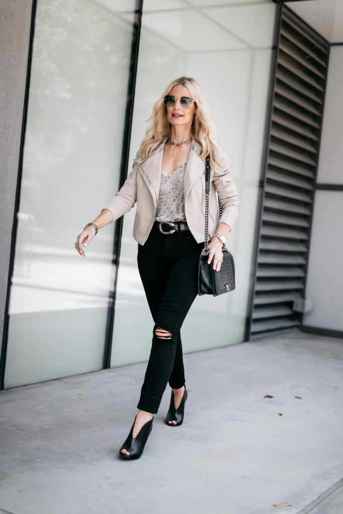 Dallas influencer wearing black skinny jeans and a Blanknyc moto jacket