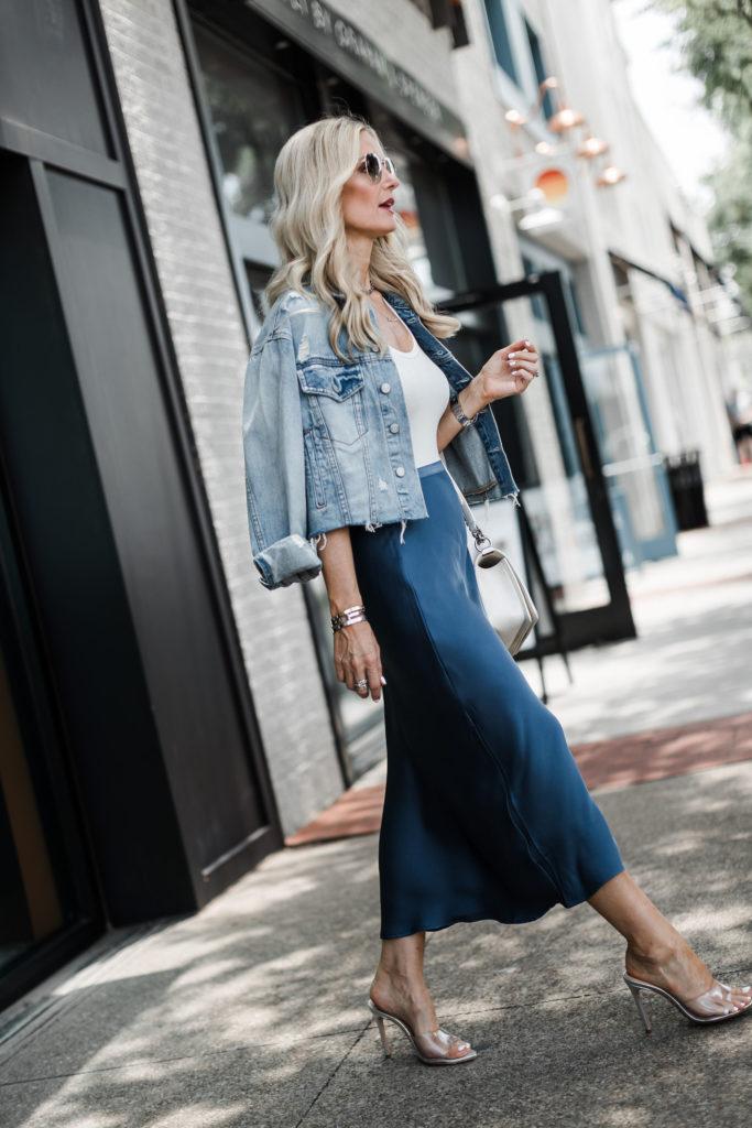Dallas blogger wearing an Anine Bing midi skirt and a denim jacket