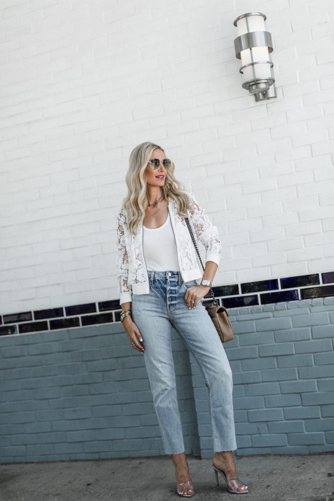 Dallas blogger wearing a white lace bomber jacket by BB Dakota
