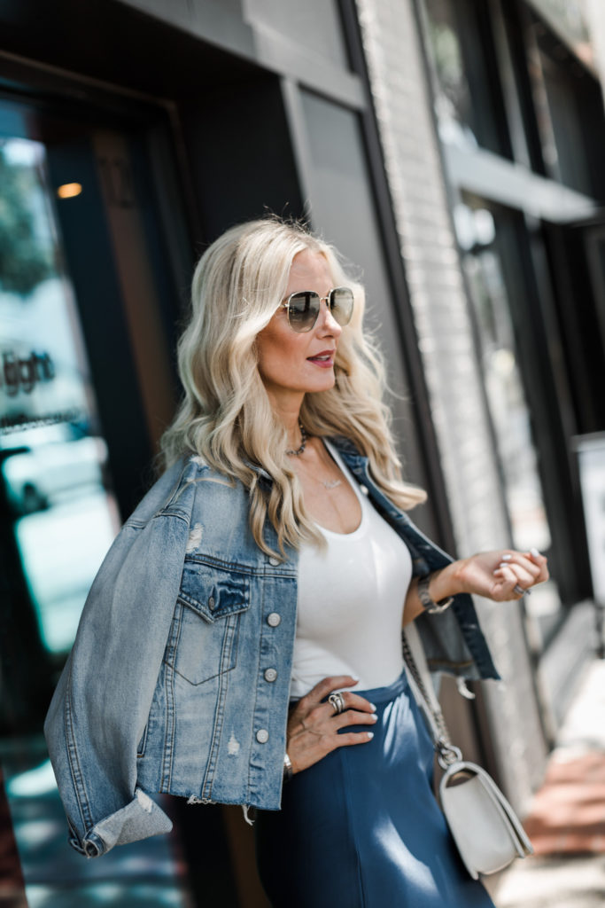 Boyish jean jacket, white bodysuit, and blue Anine Bing midi skirt