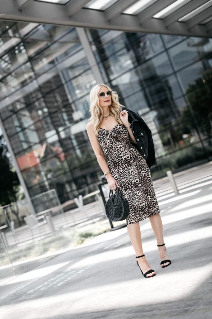 Dallas style blogger wearing a leopard midi dress