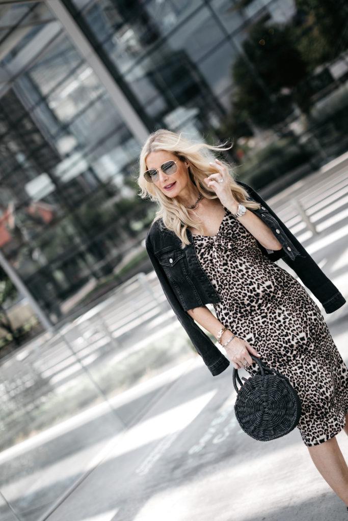 Dallas fashion blogger wearing a midi dress and black jean jacket