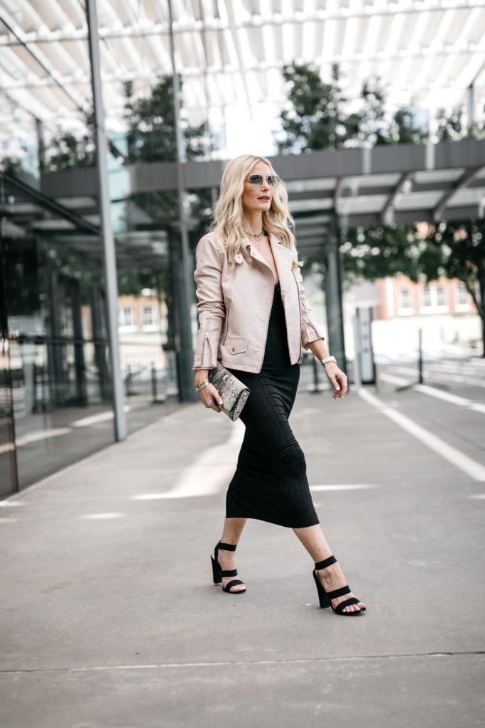 Dallas blogger wearing a Topshop moto jacket and black midi skirt