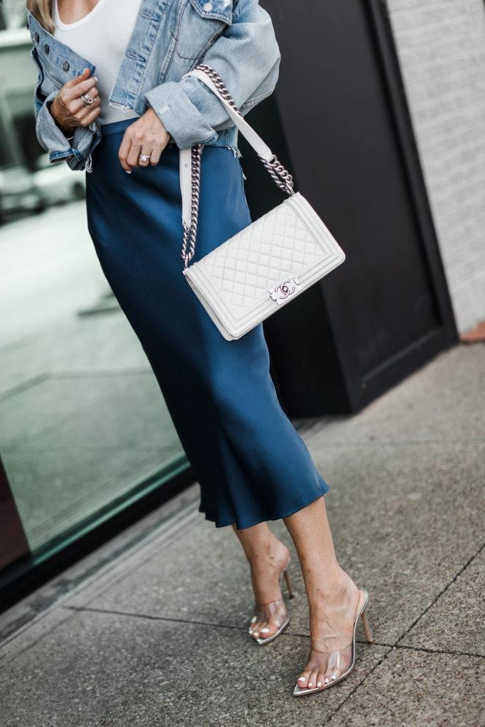 Blue Anine Bing midi skirt, Schutz heels, and a white Chanel Boy Bag