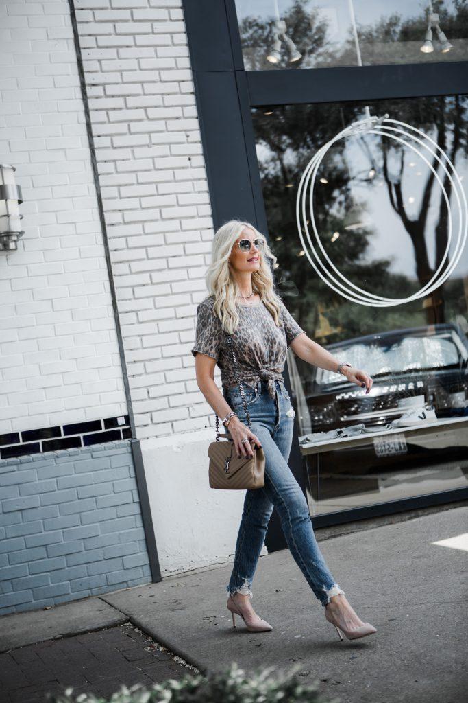 Dallas blogger carrying a Saint Laurent handbag