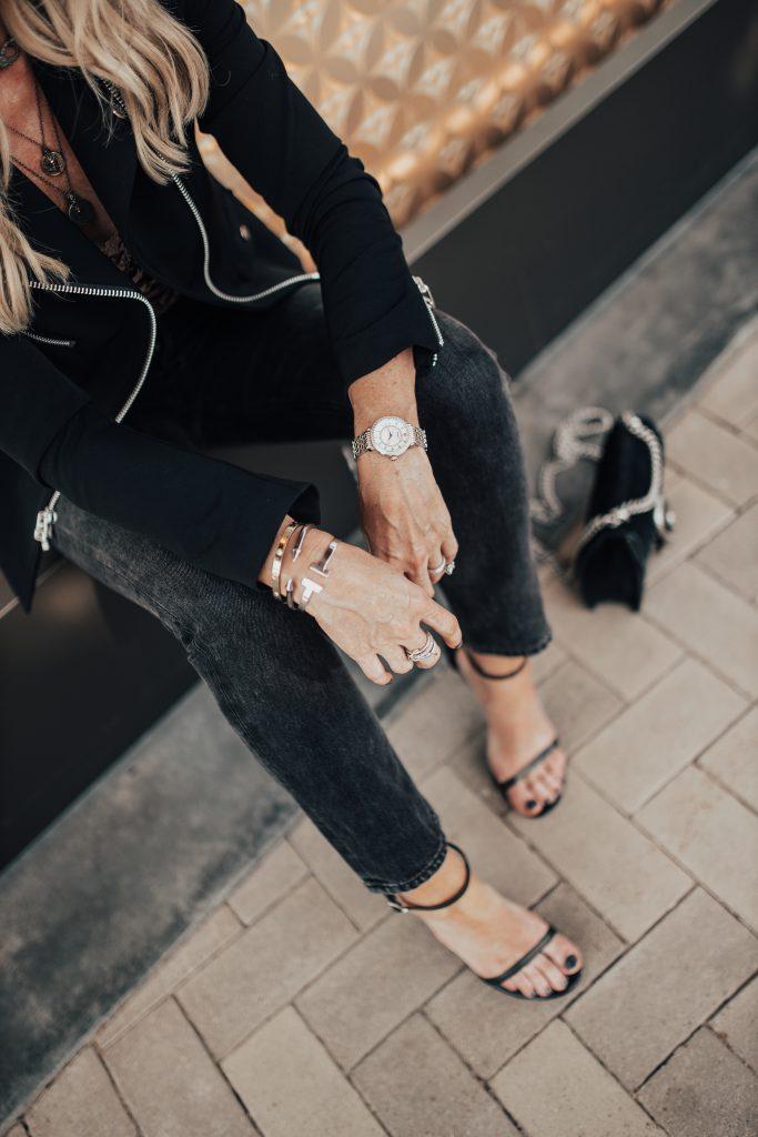 Michele watch, Agolde jeans, and Stuart Weitzman heels