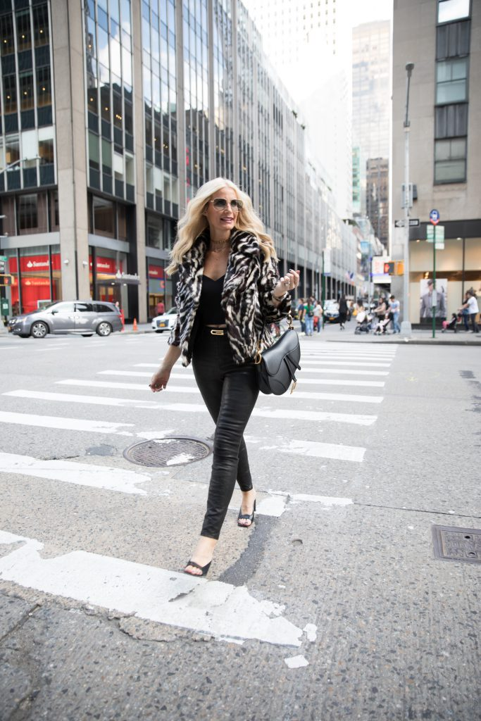 Dallas fashion blogger wearing faux fur jacket and leather pants