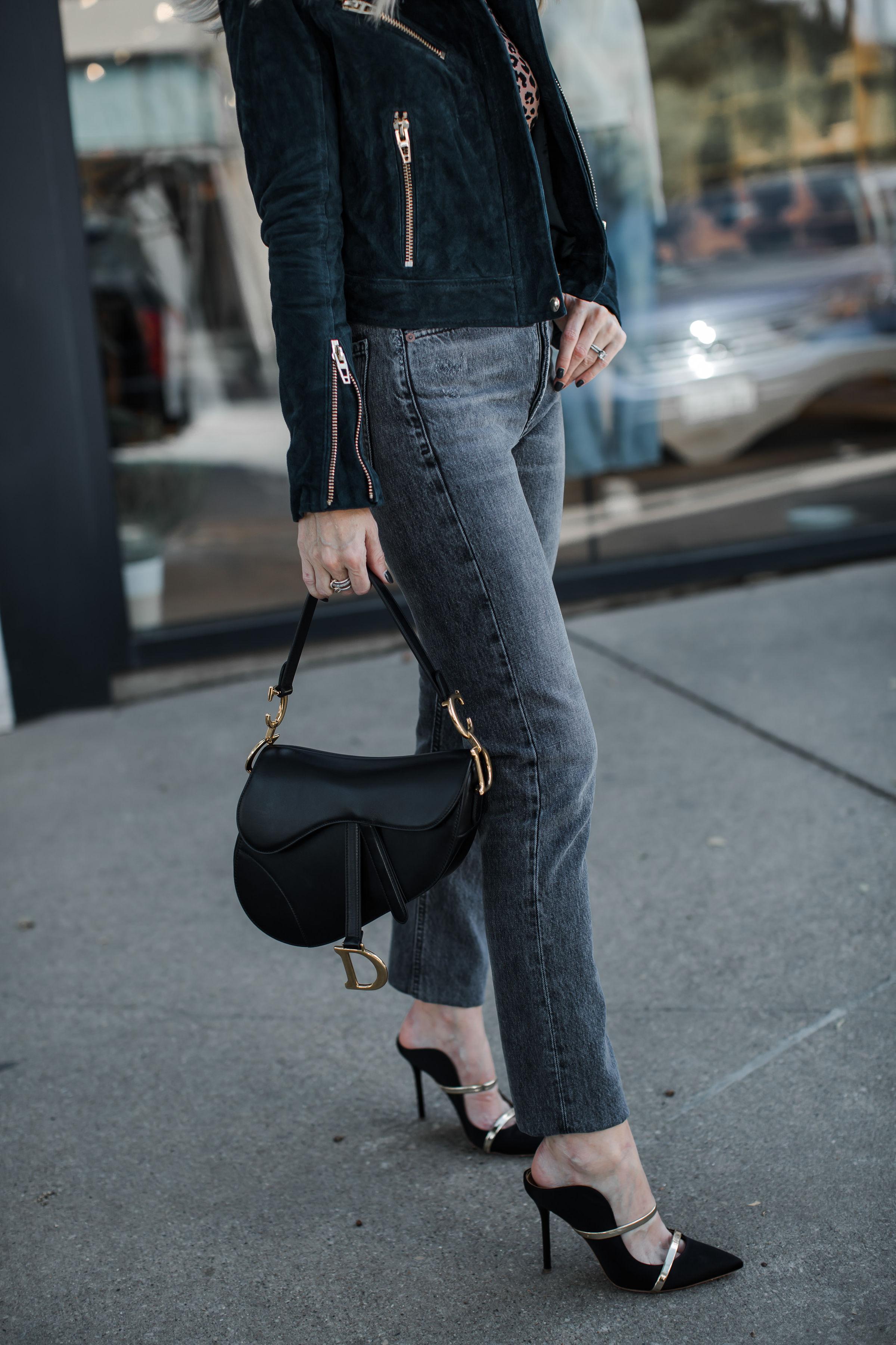 Dallas Influencer Carrying A Dior Saddle Bag