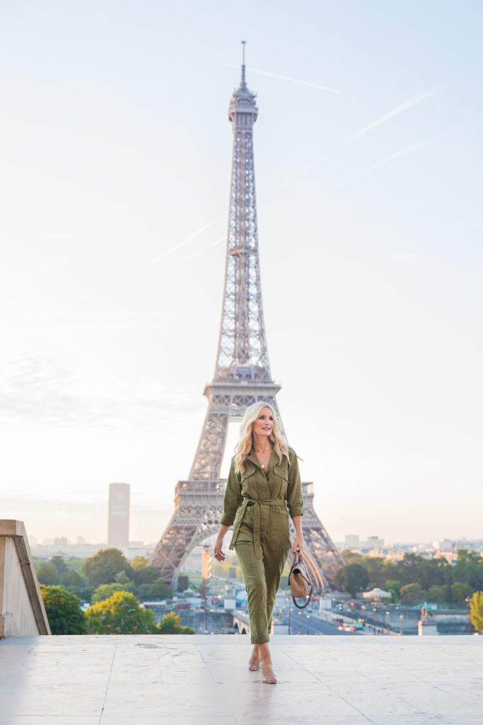 Dallas style blogger wearing a green jumpsuit in Paris