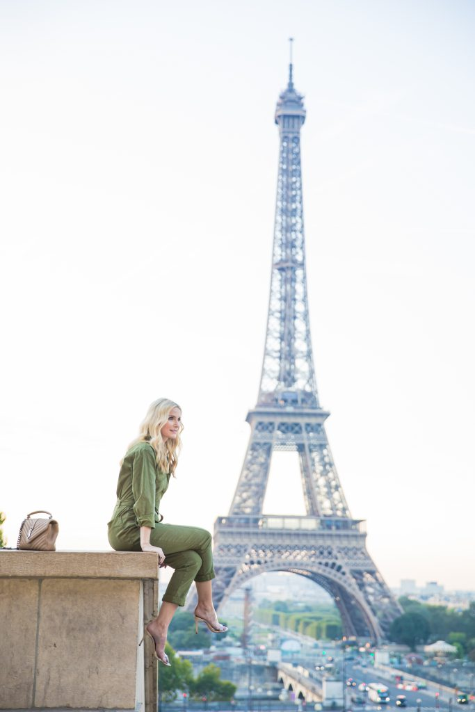 Dallas blogger wearing a green jumpsuit in Paris
