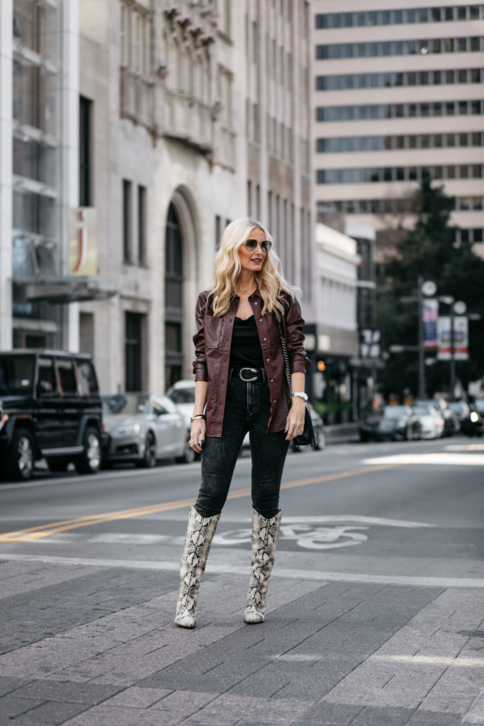 Dallas fashion blogger wearing a faux leather shirt jacket and knee high boots