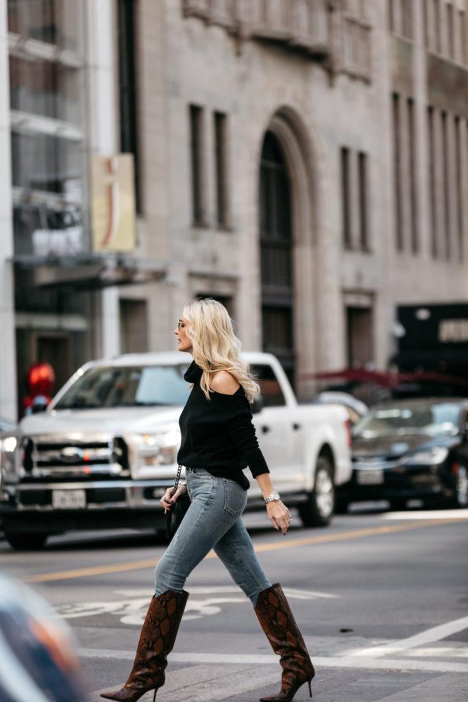 Dallas fashion blogger wearing snake print boots