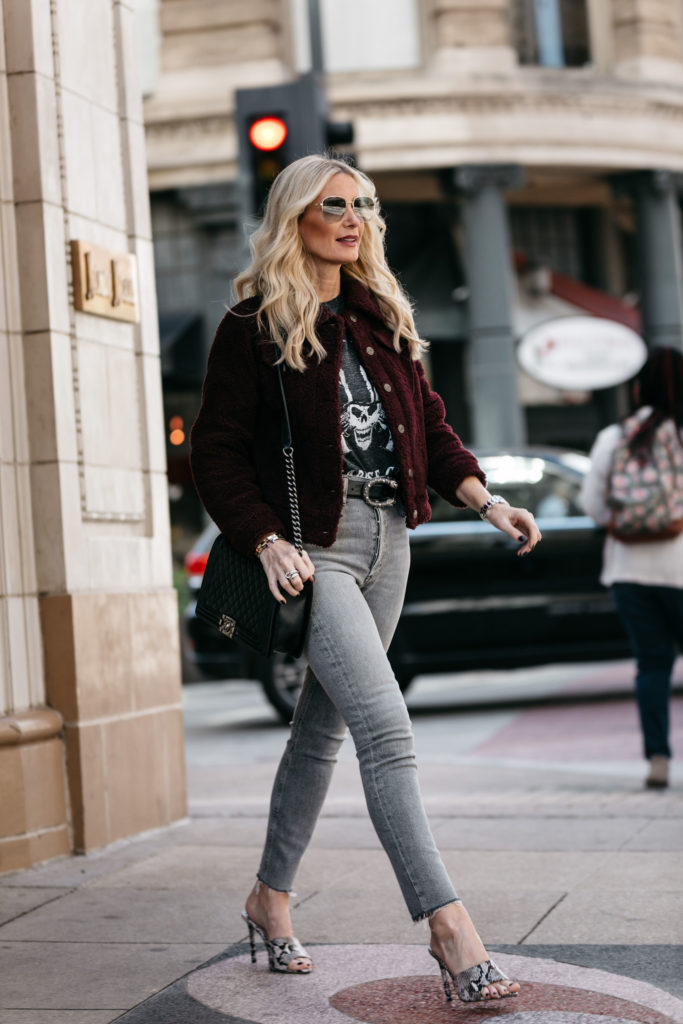 Dallas blonde wearing a faux fur jacket and Agolde jeans
