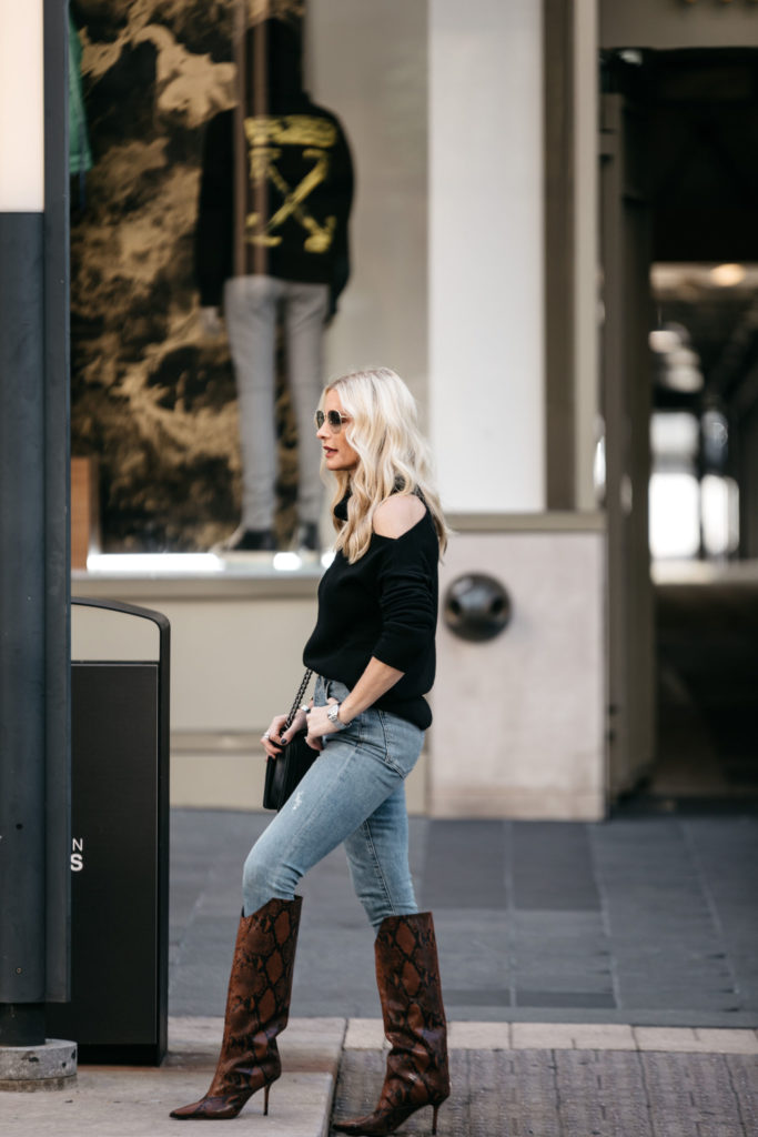 Dallas style blogger wearing denim and a black sweater