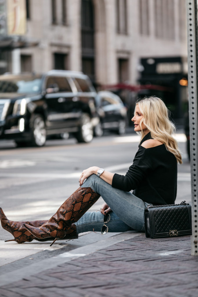 Dallas fashion blogger wearing denim and snake print boots