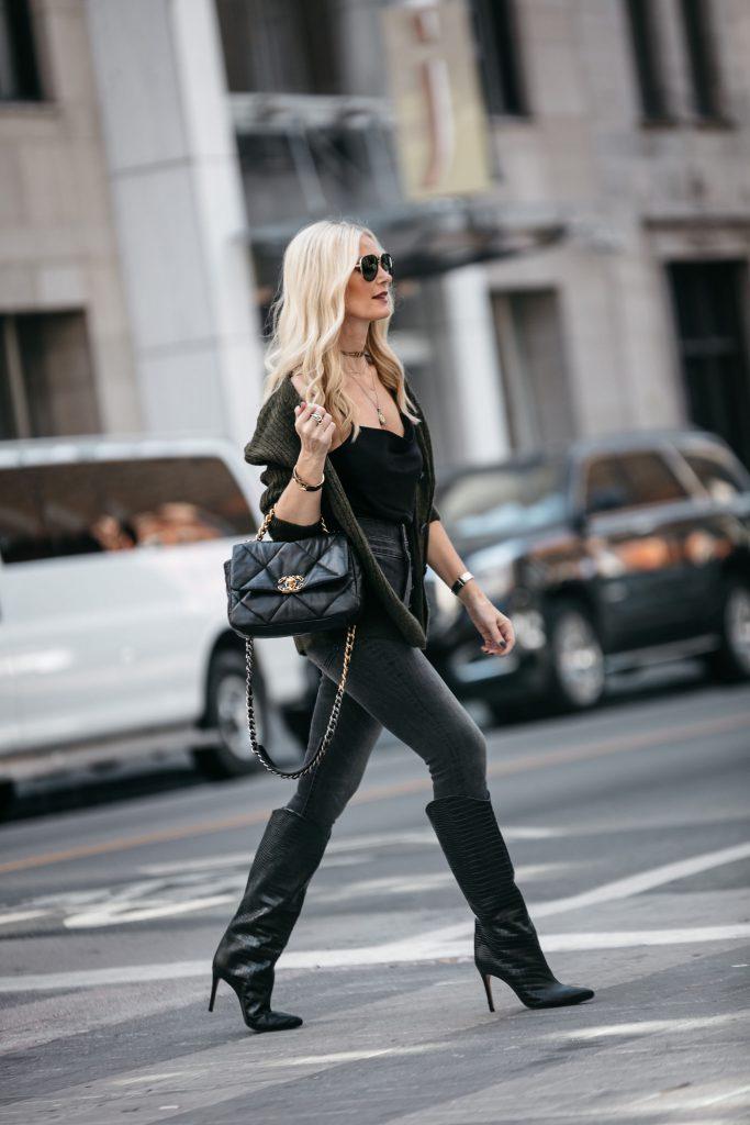 Dallas blogger wearing black denim and chanel handbag
