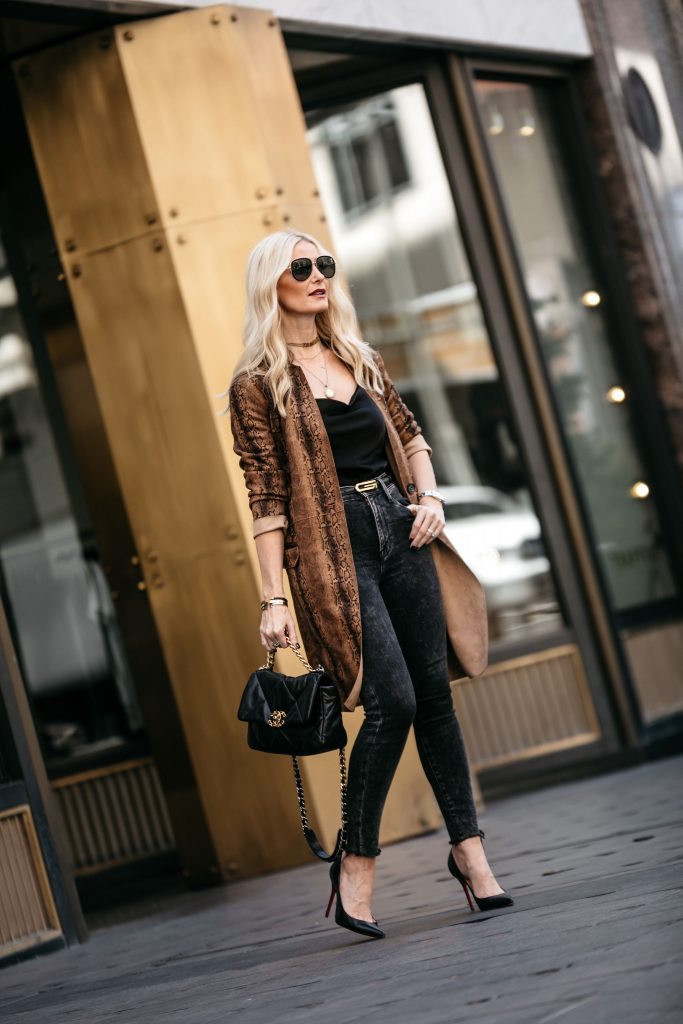 Fashion blogger wearing a snake print duster