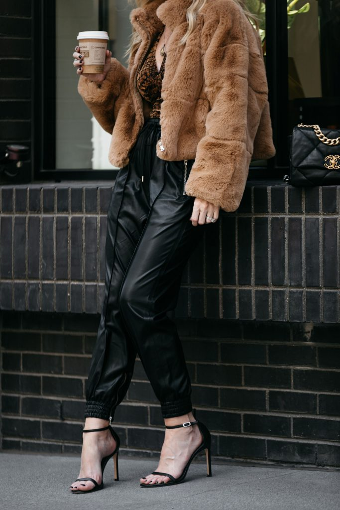 Dallas fashion blogger wearing a faux fur jacket and faux fur joggers