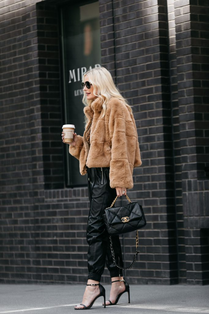 Dallas influencer wearing a faux fur jacket