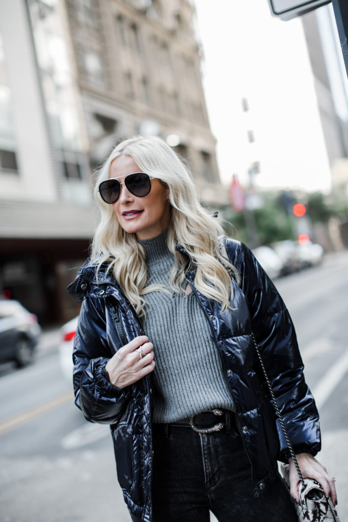 Blogger wearing Gucci sunglasses and a turtleneck sweater