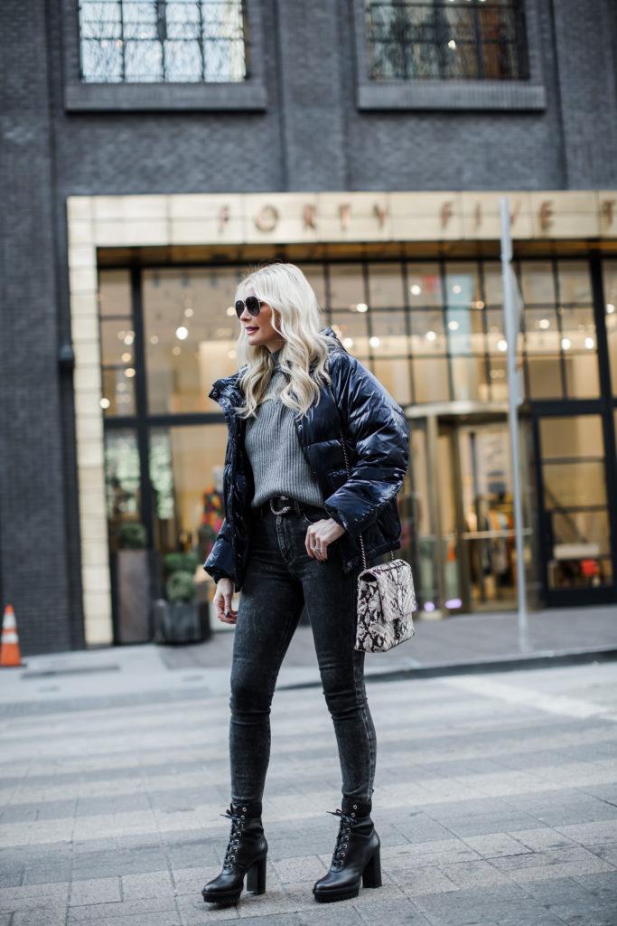 Dallas fashion blogger wearing a navy puffer jacket