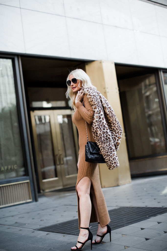 Dallas blogger wearing a faux fur jacket and a sweater dress