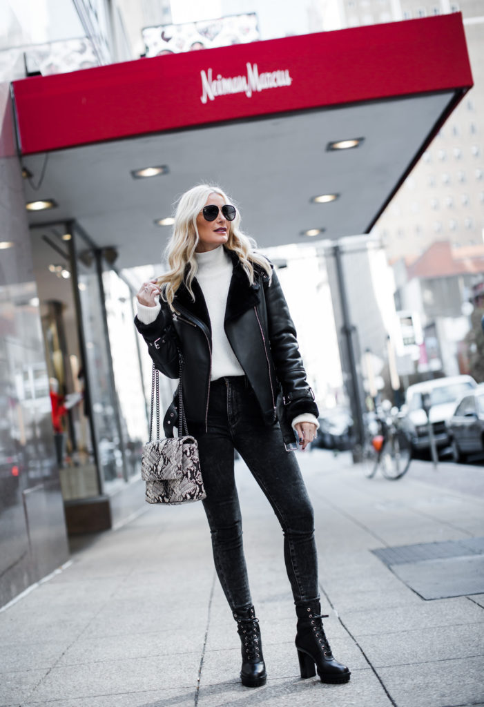 Dallas influencer wearing a shearling moto jacket and combat boots