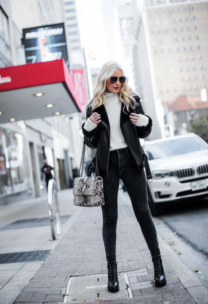 Dallas influencer wearing Frame jeans and a shearling moto jacket