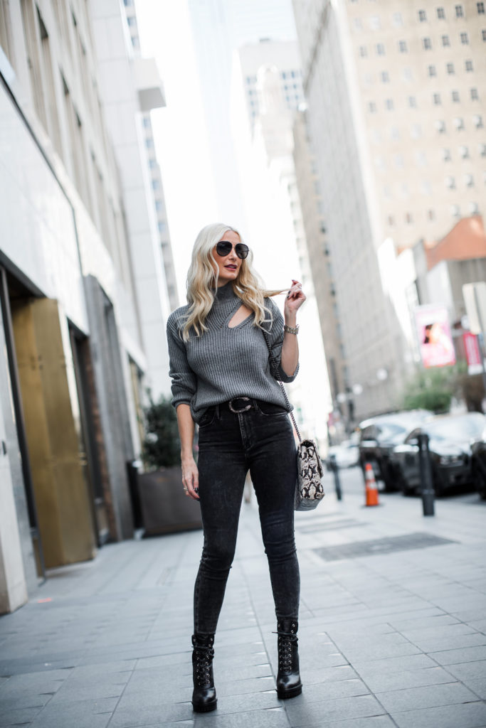 Style blogger wearing a turtleneck sweater and black denim