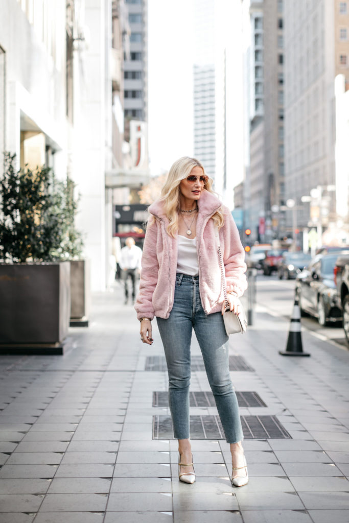 Dallas influencer wearing a Rachel Parcel faux fur bomber jacket